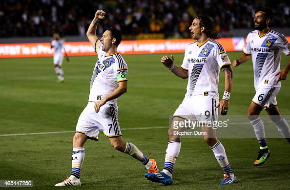 Robbie Keane of the Los Angeles Galaxy celebrates with Alan Gordon and Baggio Husidic after scoring the Galaxy's second goal in the second half...