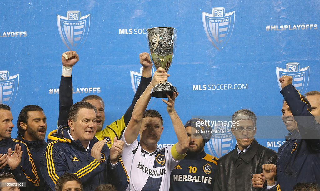 Robbie Keane #7 of the Los Angeles Galaxy hoists the Western Conference Championship trophy after defeating the Seattle Sounders FC 2-1, winning the aggregate playoff 4-2 during Leg 2 of the Western Conference Championship at CenturyLink Field on November 18, 2012 in Seattle, Washington.