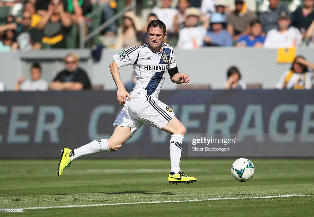 <a gi-track='captionPersonalityLinkClicked' href=/galleries/search?phrase=Robbie+Keane&family=editorial&specificpeople=171824 ng-click='$event.stopPropagation()'>Robbie Keane</a> #7 of the Los Angeles Galaxy paces the ball on the attack against Chivas USA in the second half of their MLS match at The Home Depot Center on March 17, 2013 in Carson, California. Chivas USA and the Los Angeles Galaxy played to a 1-1 draw.