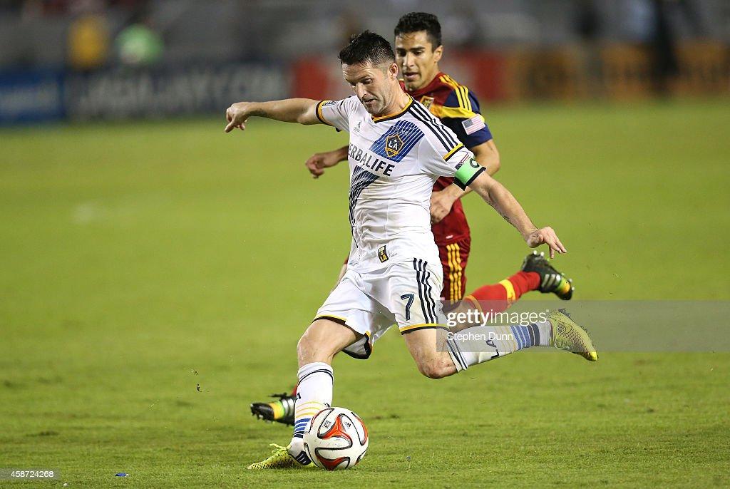 Robbie Keane of the Los Angeles Galaxy passes the ball away from Tony Betran of Real Salt Lake in Leg 2 of the Western Conference Semifinals at...