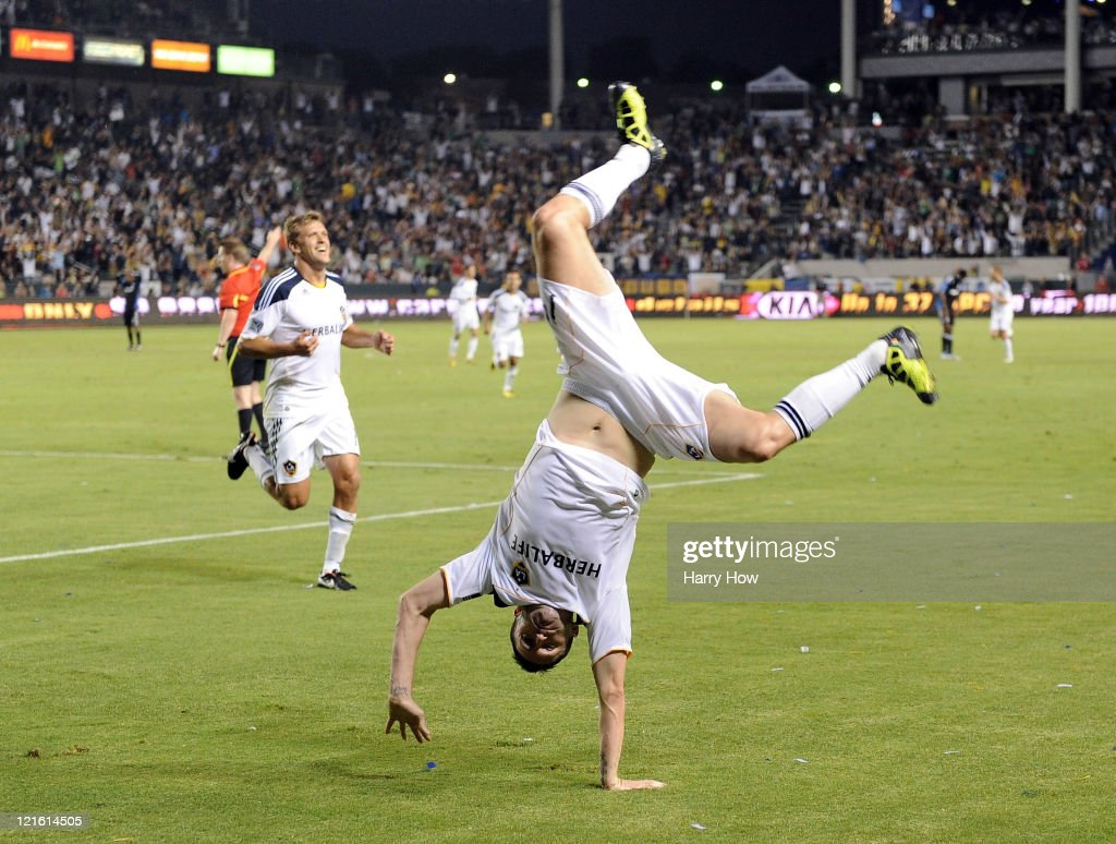 Robbie Keane of the Los Angeles Galaxy performs a cartwheel in celebration of his goal in his debut game for a 10 lead over the San Jose Earthquakes...