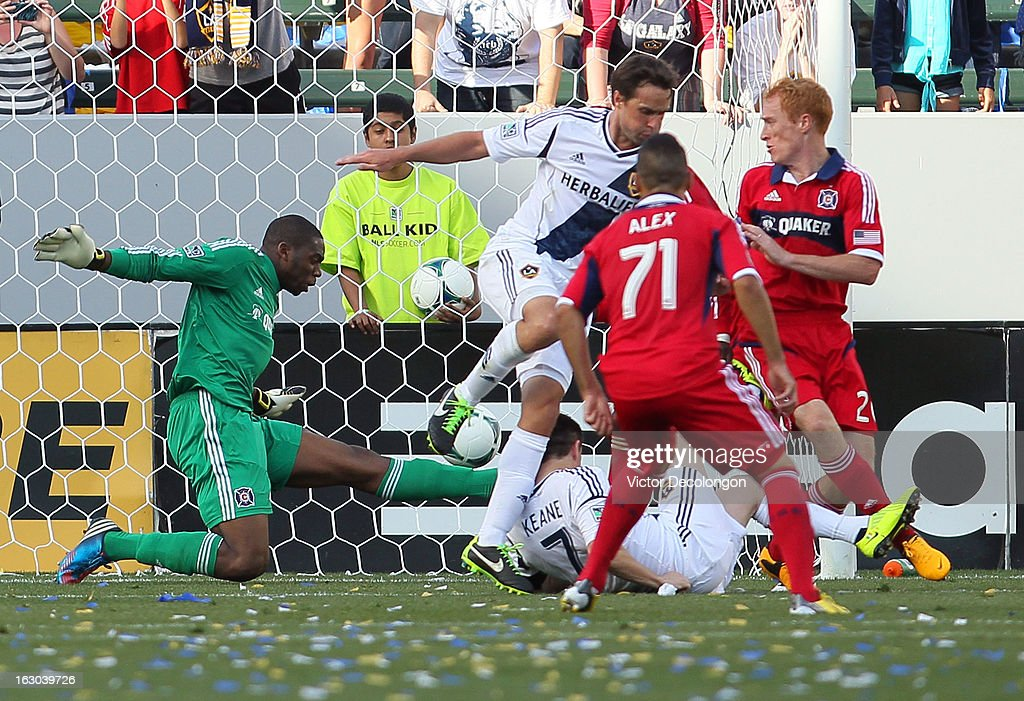 Robbie Keane #7 of the Los Angeles Galaxy scores a goal against goalkeeper Sean Johnson #25 of the Chicago Fire in the second half during the MLS match at The Home Depot Center on March 3, 2013 in Carson, California. The Galaxy defeated the Fire 4-0.