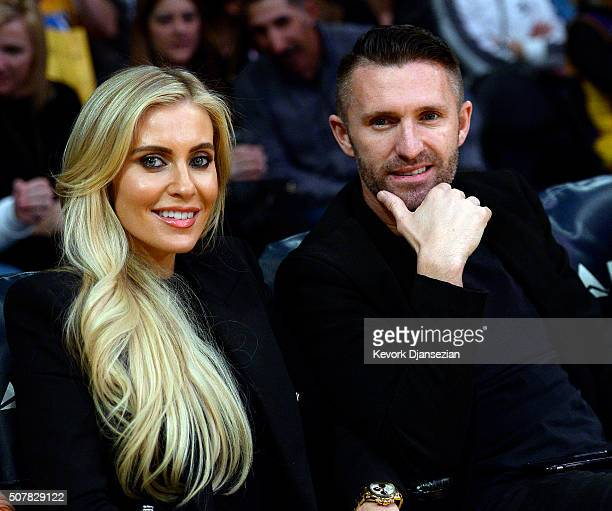 Robbie Keane of the Los Angeles Galaxy soccer team and his wife Claudine Keane attend the basketball game between the Los Angeles Lakers and...