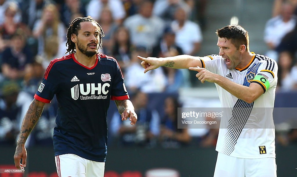 Robbie Keane of the Los Angeles Galaxy yells instructions to a teammate as Jermaine Jones of the New England Revolution looks on during a break in...