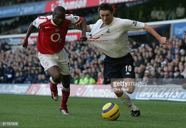 Robbie Keane of Tottenham battles with Lauren of Arsenal during the Barclays Premiership match between Tottenham Hotpsur and Arsenal at White Hart...