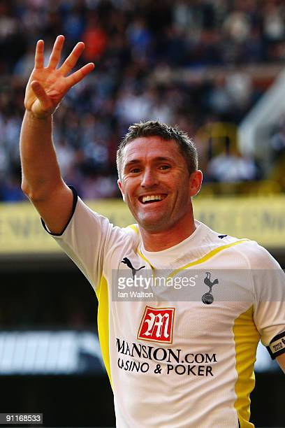 Robbie Keane of Tottenham Hotspur celebrates his fourth goal during the Barclays Premier League match between Tottenham Hotspur and Burnley at White...