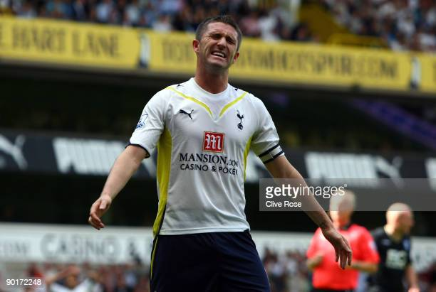 Robbie Keane of Tottenham Hotspur reacts after missing a scoring chance during the Barclays Premier League match between Tottenham Hotspur and...