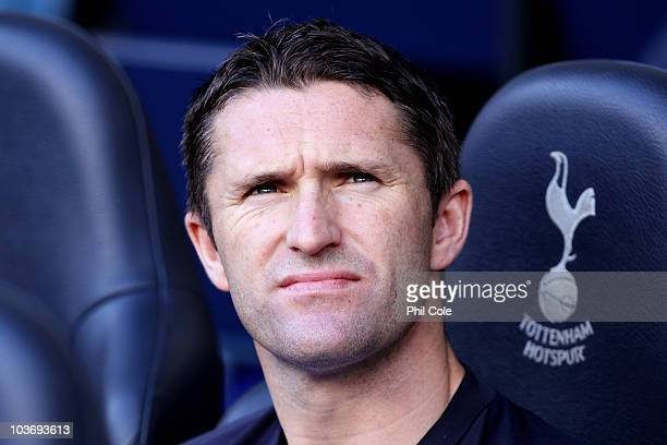 Robbie Keane of Tottenham looks on from the bench during the Barclays Premier League match between Tottenham Hotspur and Wigan Athletic at White Hart...