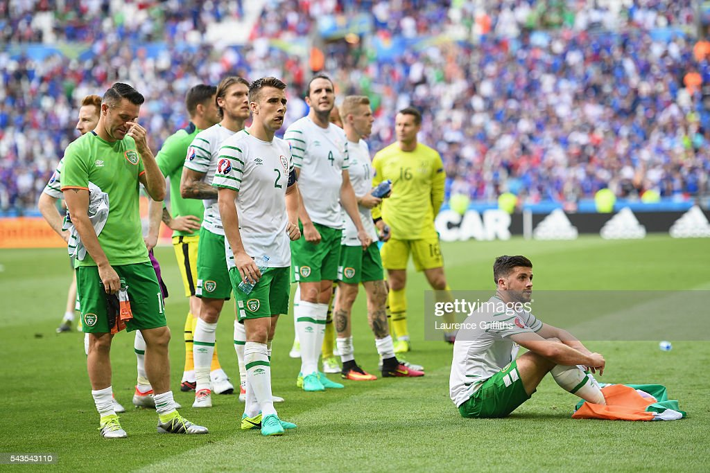 Robbie Keane, Seamus Coleman and Shane Long of Republic of Ireland show their disappointmen after defeat in the UEFA Euro 2016 match between France and Republic of Ireland at Stade des Lumieres on June 26, 2016 in Lyon, France.