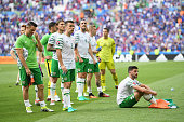 Robbie Keane Seamus Coleman and Shane Long of Republic of Ireland show their disappointmen after defeat in the UEFA Euro 2016 match between France...