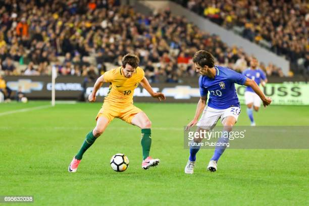 Robbie Kruse competes with Rodrigo Caio Russo during play as Brazil plays Australia in the Chevrolet Brasil Global Tour 2017 on June 13 2017 in...