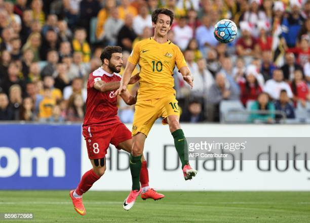 Robbie Kruse of Australia clears the ball ahead of Syria's Mahmoud Almawas during their 2018 World Cup football qualifying match played in Sydney on...