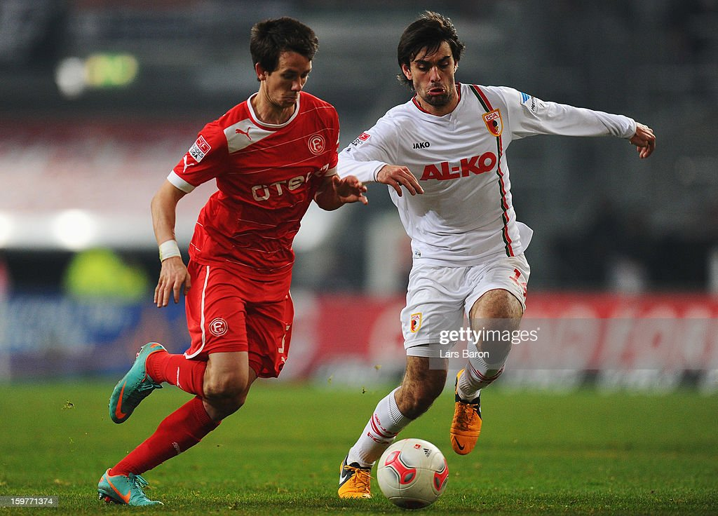 Robbie Kruse of Duesseldorf is challenged by Jan Moravek of Augsburg during the Bundesliga match between Fortuna Duesseldorf 1895 and FC Augsburg at Esprit-Arena on January 20, 2013 in Duesseldorf, Germany.