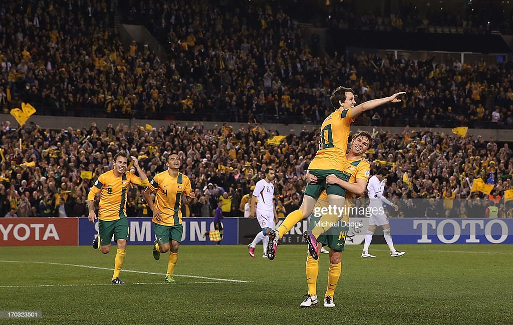 <a gi-track='captionPersonalityLinkClicked' href=/galleries/search?phrase=Robbie+Kruse&family=editorial&specificpeople=4449553 ng-click='$event.stopPropagation()'>Robbie Kruse</a> of the Socceroos gets lifted up by <a gi-track='captionPersonalityLinkClicked' href=/galleries/search?phrase=Brett+Holman&family=editorial&specificpeople=2224226 ng-click='$event.stopPropagation()'>Brett Holman</a> as he celebrates a goal during the FIFA World Cup Qualifier match between the Australian Socceroos and Jordan at Etihad Stadium on June 11, 2013 in Melbourne, Australia.
