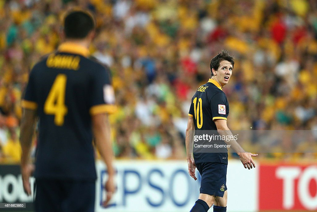Robbie Kruse of the Socceroos reacts to team mate Tim Cahill during the 2015 Asian Cup match between Australia and Korea Republic at Suncorp Stadium on January 17, 2015 in Brisbane, Australia.