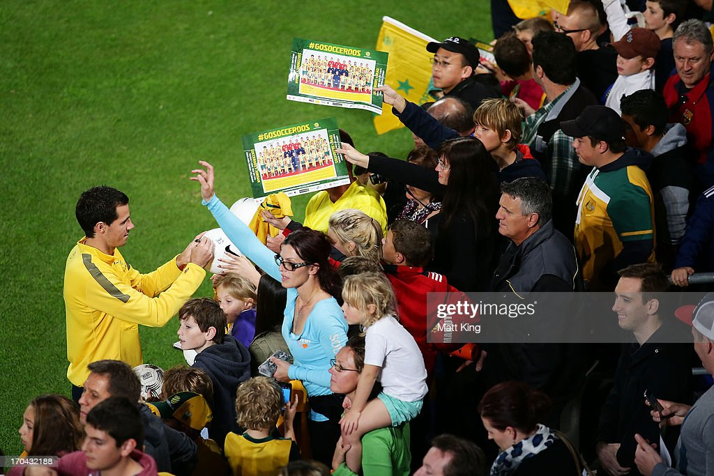 <a gi-track='captionPersonalityLinkClicked' href=/galleries/search?phrase=Robbie+Kruse&family=editorial&specificpeople=4449553 ng-click='$event.stopPropagation()'>Robbie Kruse</a> signs autographs for fans during an Australian Socceroos training session at WIN Jubilee Stadium on June 13, 2013 in Sydney, Australia.