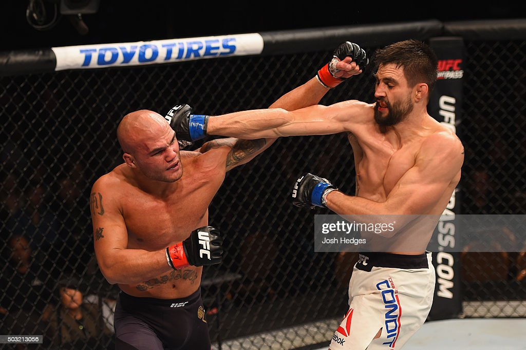 Robbie Lawler and Carlos Condit exchange punches in their UFC welterweight championship bout during the UFC 195 event inside MGM Grand Garden Arena on January 2, 2016 in Las Vegas, Nevada.