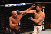 Robbie Lawler and Carlos Condit exchange punches in their UFC welterweight championship bout during the UFC 195 event inside MGM Grand Garden Arena...