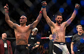 Robbie Lawler and Carlos Condit raise each others hands after their welterweight championship fight during the UFC 195 event inside MGM Grand Garden...