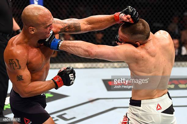 Robbie Lawler and Rory MacDonald exchange punches in their UFC welterweight title fight during the UFC 189 event inside MGM Grand Garden Arena on...