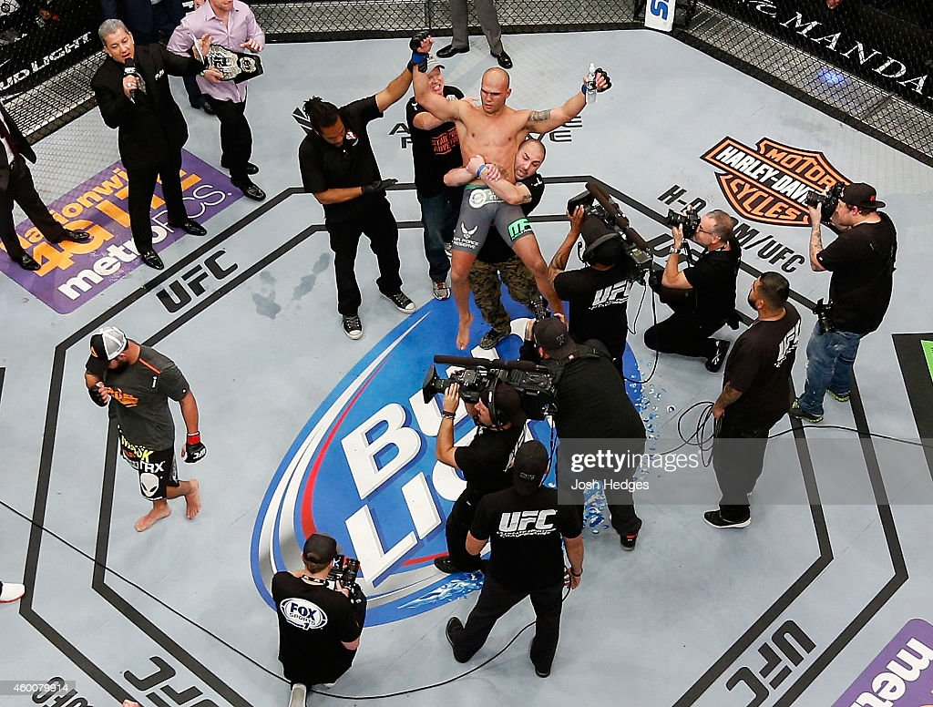 Robbie Lawler celebrates after being announced the new UFC welterweight champion winning by split decision over Johny Hendricks in their UFC welterweight championship bout during the UFC 181 event inside the Mandalay Bay Events Center on December 6, 2014 in Las Vegas, Nevada.