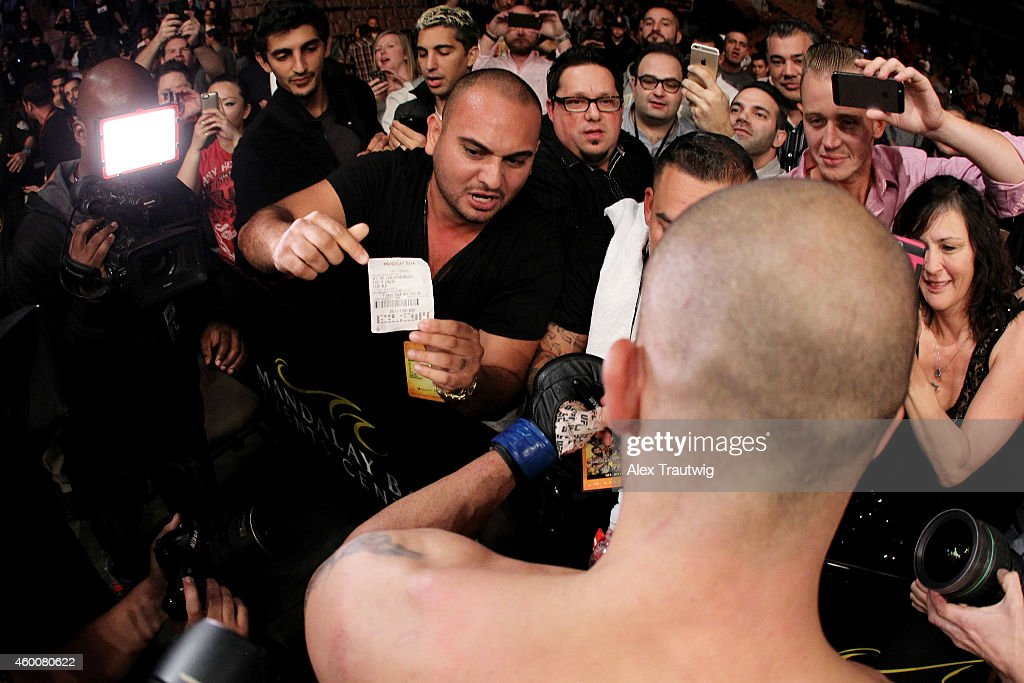 Robbie Lawler celebrates with fans after defeating Johny Hendricks by a split decision in their welterweight title fight during the UFC 181 event at the Mandalay Bay Events Center on December 6, 2014 in Las Vegas, Nevada.