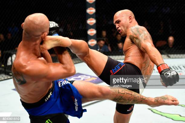 Robbie Lawler kicks Donald Cerrone in their welterweight bout during the UFC 214 event at Honda Center on July 29 2017 in Anaheim California