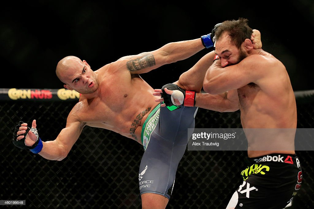 Robbie Lawler kicks Johny Hendricks in their welterweight title fight during the UFC 181 event at the Mandalay Bay Events Center on December 6, 2014 in Las Vegas, Nevada.