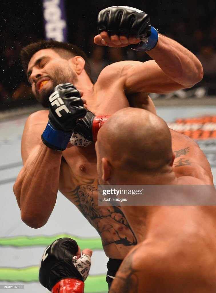 Robbie Lawler punches Carlos Condit in their UFC welterweight championship bout during the UFC 195 event inside MGM Grand Garden Arena on January 2...