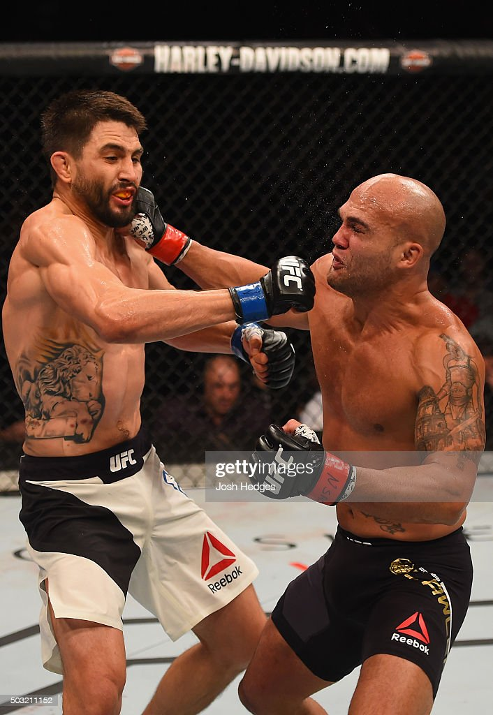 Robbie Lawler punches Carlos Condit in their UFC welterweight championship bout during the UFC 195 event inside MGM Grand Garden Arena on January 2, 2016 in Las Vegas, Nevada.