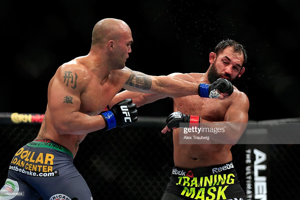 Robbie Lawler punches Johny Hendricks in their welterweight title fight during the UFC 181 event at the Mandalay Bay Events Center on December 6, 2014 in Las Vegas, Nevada.