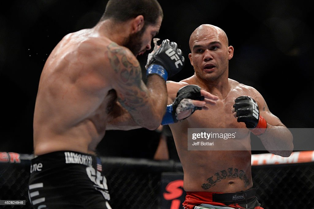 <a gi-track='captionPersonalityLinkClicked' href=/galleries/search?phrase=Robbie+Lawler&family=editorial&specificpeople=4165234 ng-click='$event.stopPropagation()'>Robbie Lawler</a> punches <a gi-track='captionPersonalityLinkClicked' href=/galleries/search?phrase=Matt+Brown+-+Fighter&family=editorial&specificpeople=12802513 ng-click='$event.stopPropagation()'>Matt Brown</a> in their welterweight bout during the UFC Fight Night event at the SAP Center on July 26, 2014 in San Jose, California.