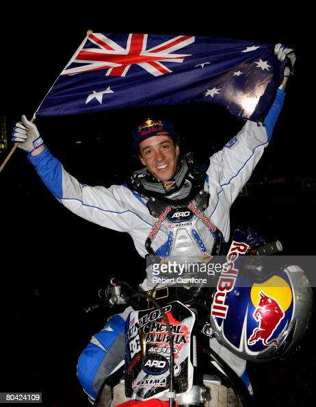 Robbie Maddison of Australia celebrates after breaking the world record for a ramp to dirt jump of 351feet during the Crusty Demons night of world...