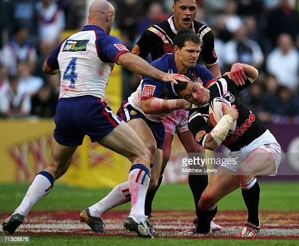 Robbie Paul of New Zealand is tackled by Stuart Fielden of Great Briatin during the XXXX Test match between Great Britain and New Zealand at Knowsley...