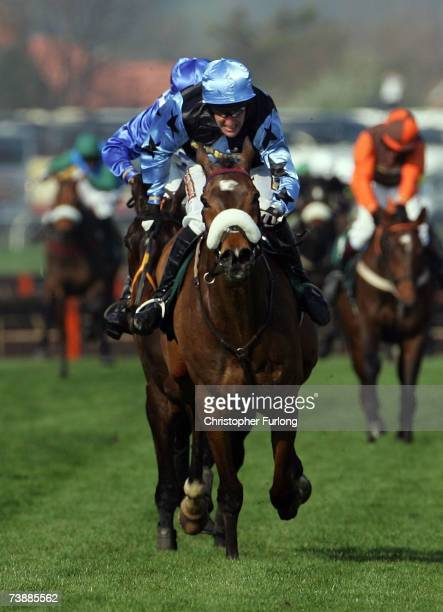 Robbie Power and Silver Birch race along the home straight to win The John Smiths' Grand National Steeple Chase Race run at Aintree on April 14 in...