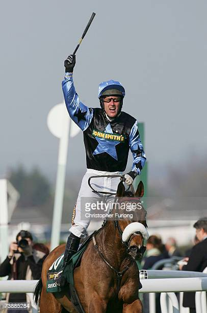 Robbie Power celebrates as he and Silver Birch win The John Smiths' Grand National Steeple Chase Race run at Aintree on April 14 in Aintree England