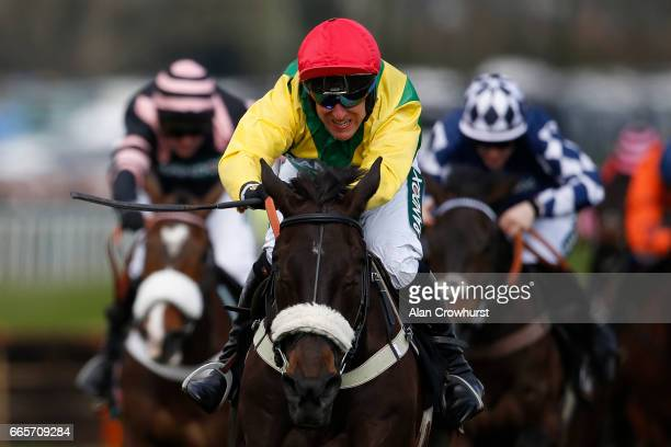 Robbie Power riding Pingshou the last to win The Crabbieâs Top Novicesâ Hurdle Race at Aintree Racecourse on April 7 2017 in Liverpool England