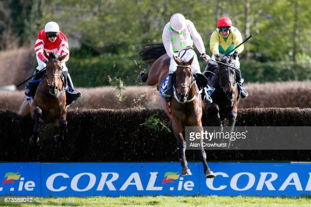 Robbie Power riding Sizing John clear the last to win The Coral Punchestown Gold Cup from Djakadam and Coneygree at Punchestown racecourse on April...