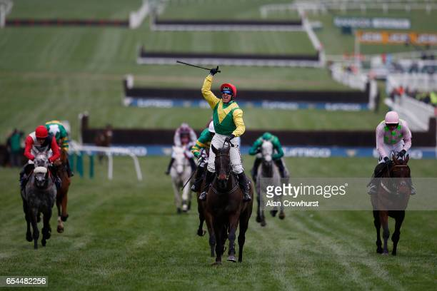 Robbie Power riding Sizing John win The Timico Cheltenham Gold Cup Steeple Chase during Gold Cup day on day four of the festival meeting at...