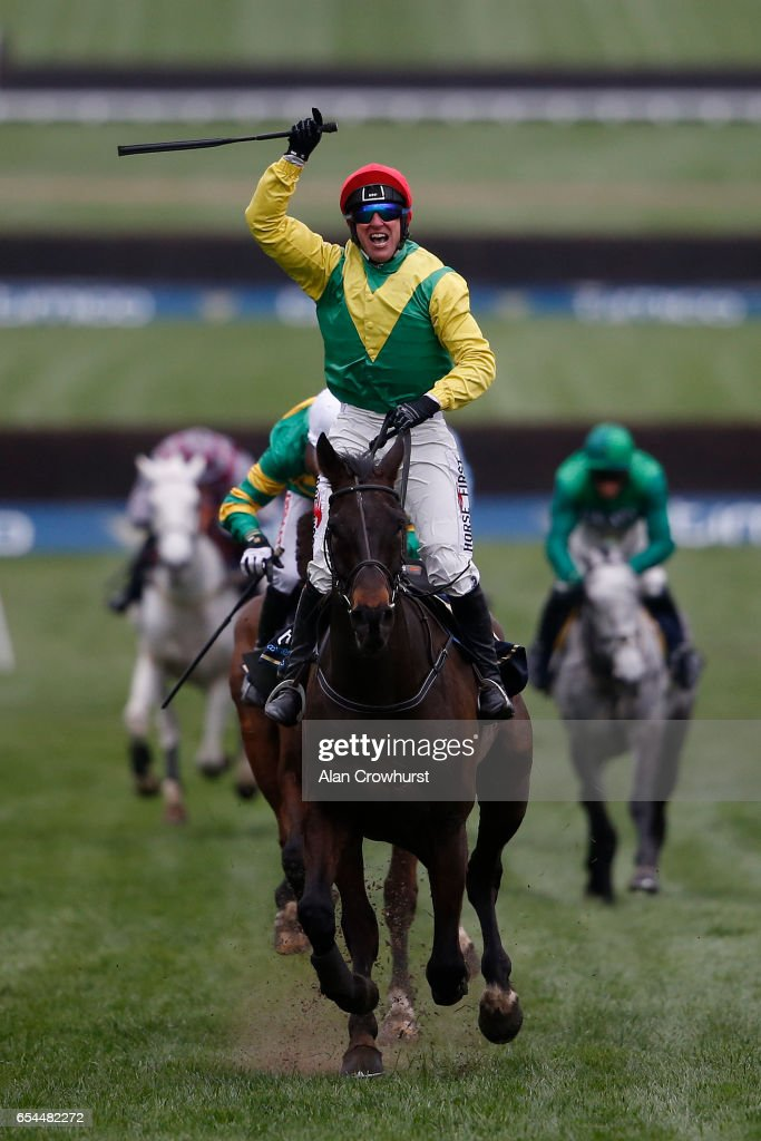 Robbie Power riding Sizing John win The Timico Cheltenham Gold Cup Steeple Chase during Gold Cup day on day four of the festival meeting at Cheltenham racecourse on March 17, 2017 in Cheltenham, England.