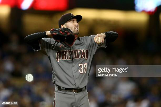 Robbie Ray of the Arizona Diamondbacks looks on after giving up a run on a sacrifice fly by Logan Forsythe of the Los Angeles Dodgers during the...