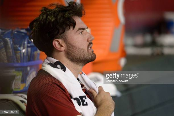 Robbie Ray of the Arizona Diamondbacks looks on from the dugout in the first inning of the MLB game against the Milwaukee Brewers at Chase Field on...