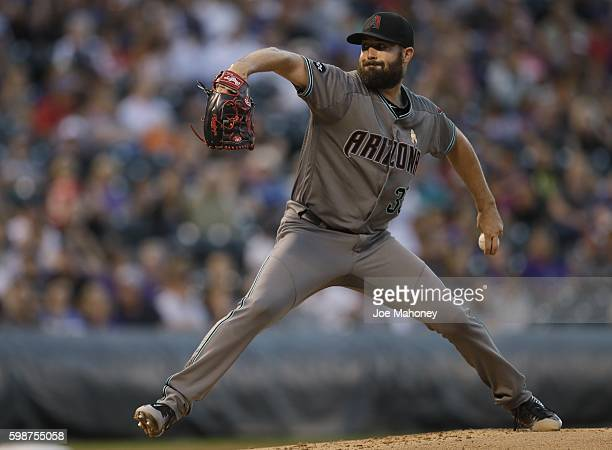 Robbie Ray of the Arizona Diamondbacks pitches against the Colorado Rockies during the second inning of a baseball game at Coors Field on September 2...