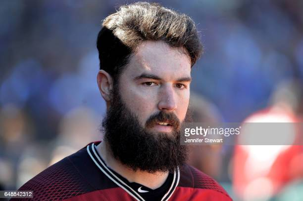 Robbie Ray of the Arizona Diamondbacks reacts in the dugout in the spring training game against the Kansas City Royals at Surprise Stadium on March 6...
