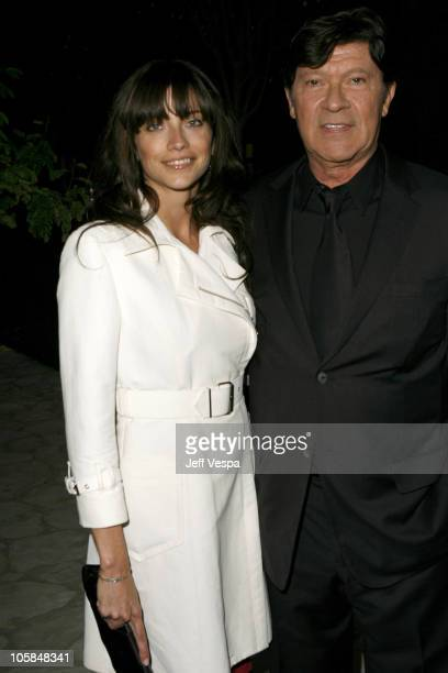 Robbie Robertson and guest during Giorgio Armani Prive in LA Inside at Green Acres in Los Angeles California United States