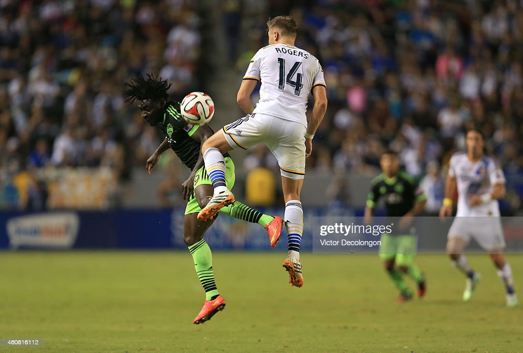 Robbie Rogers #14 of Los Angeles Galaxy and Obafemi Martins #9 of Seattle Sounders FC vie for the ball during the MLS match at StubHub Center on October 19, 2014 in Los Angeles, California. The Sounders and Galaxy played to a 2-2 draw.