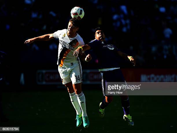 Robbie Rogers of Los Angeles Galaxy and Sebastian Hines of Orlando City FC jump for a header during a 42 Galaxy win at StubHub Center on September 11...