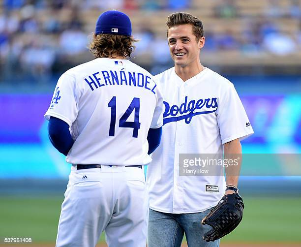 Robbie Rogers of the Los Angeles Galaxy shakes hands with Enrique Hernandez of the Los Angeles Dodgers after throwing out a ceremonial first pitch...