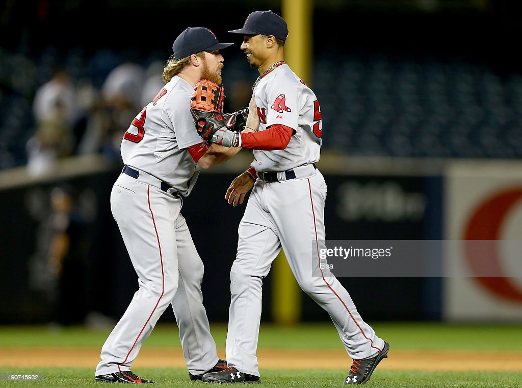 Robbie Ross Jr. #28 and Mookie Betts #50 of the Boston Red Sox celebrate the win over the New York Yankees on September 30, 2015 at Yankee Stadium in the Bronx borough of New York City.The Boston Red Sox defeated the New York Yankees 9-5 in 11 innings.