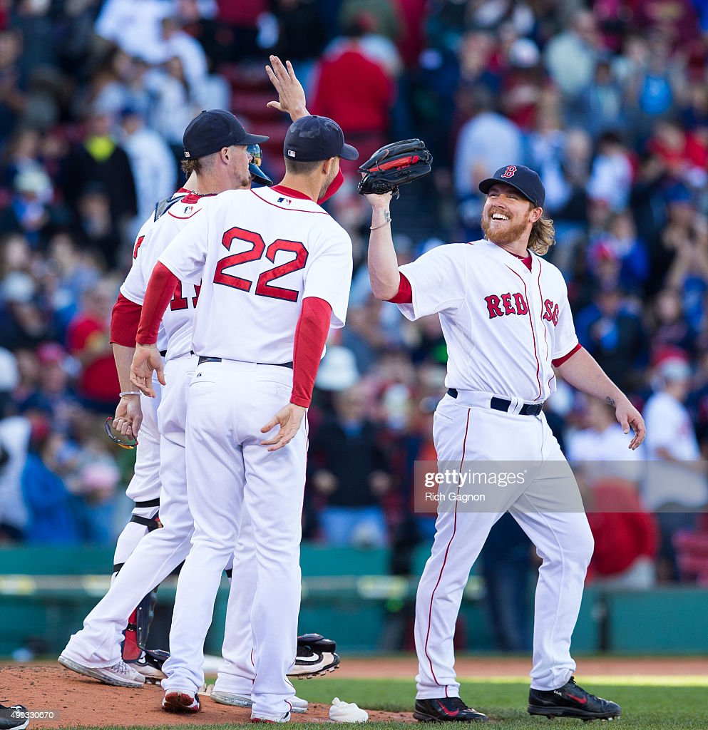 Robbie Ross Jr. #28 of the Boston Red Sox celebrates a 2-0 victory with teammate Clay Buchholz #11 and Rick Porcello #22 after pitching during the ninth inning against the Baltimore Orioles at Fenway Park on September 27, 2015 in Boston, Massachusetts.